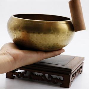 Bol chantant en cuivre